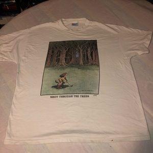 Gary Patterson, 90 T-shirt, shot through the trees
